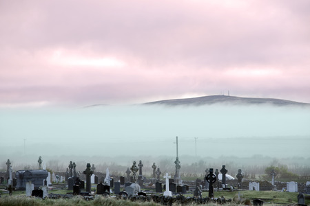 Fog rolling into the graveyard next to Ballybunion golf course in county Kerry Ireland photo