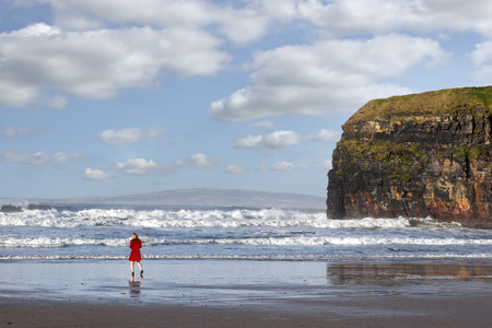 ballybunion: woman in high heels at cliffs of Ballybunion on the wild atlantic way in county Kerry Ireland Stock Photo