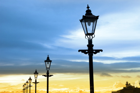youghal: lighthouse and row of vintage lamps on the promenade in Youghal county Cork Ireland