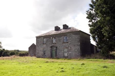 abandoned farmhouse abandoned farmhouse: old abandoned farmhouse in the countryside of county Longford Ireland in black and white Stock Photo