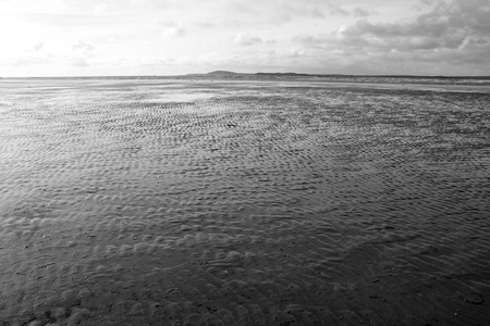 ripples of sand on the beach in Beal county Kerry Ireland in black and white photo