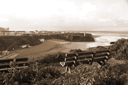 ballybunion: benches on a cliff edge  with views of Ballybunion beach and coast at sunset in sepia