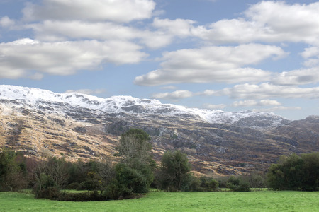 irish countryside: rocky mountain and fields countryside snow scene in irish speaking area of county Kerry Ireland with copyspace Stock Photo