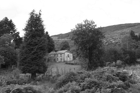old abandoned farmhouse in the mountains of county Kerry Ireland in black and white photo