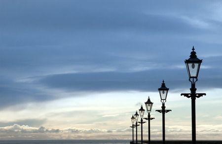 youghal: row of vintage lamps on the promenade in Youghal county Cork Ireland Stock Photo