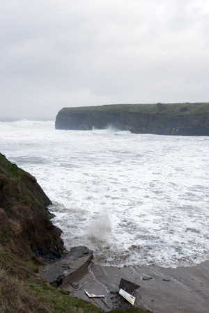 ballybunion: Ballybunion seaside beach and cliffs during a very bad storm with crashing waves