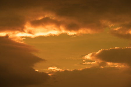 god in heaven: beautiful cloudy orange sunset sky in the wild Atlantic way, Ireland with sunbeams Stock Photo