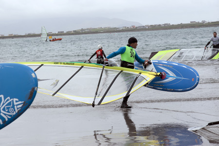 windsurfers: windsurfers getting ready to surf on the beach in the maharees county kerry ireland Editorial