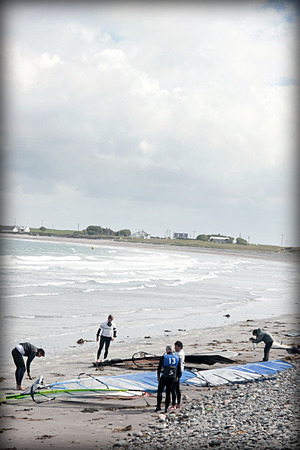 windsurfers: windsurfers getting equipment ready on the beach in the maharees county kerry ireland Editorial