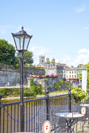 beautiful antique street lamp and riverside view of kilkenny castle in ireland