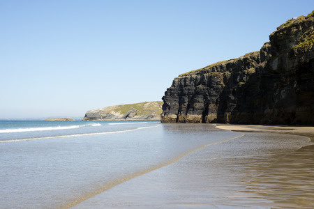 ballybunion beach and cliffs on the wild atlantic way at low tide photo
