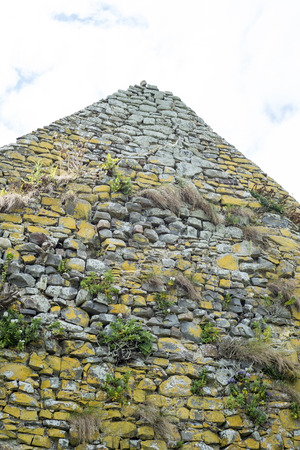 weed block: old stone walls from the ruin of an old church on the wild atlantic way in ireland