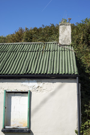 galvanised: old white washed home with galvanised roof
