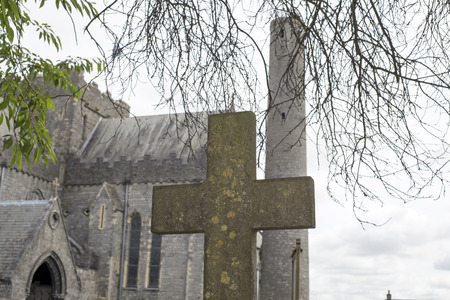 cross at ancient graveyard in St Canice?s Cathedral in kilkenny city ireland photo