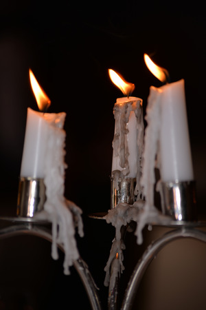 candles lighting and dripping at a restaurant photo