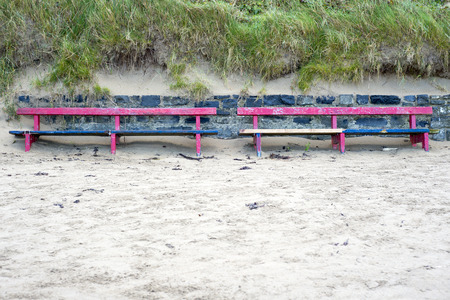 beach front: Ballybunion seaside benches in sand drifts on the beach front