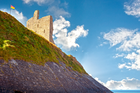 cliff face: ballybunion castle with the cliff face on the wild atlantic way ireland