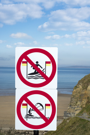 surfers: warning signs for surfers in ballybunion on the wild atlantic way in ireland