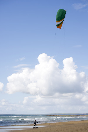 kiting: kite boarder on beautiful sandy beach in ballybunion county kerry ireland Stock Photo