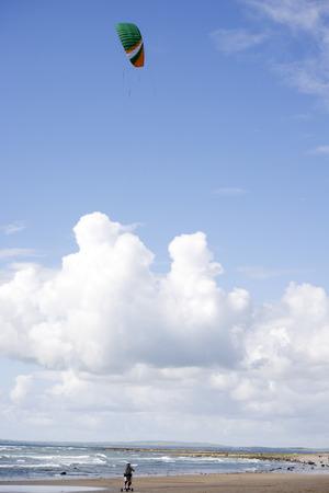 kiter: kite boarder on beautiful sandy beach in ballybunion county kerry ireland Stock Photo