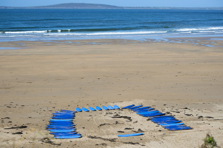 surfboard fin: surf boards on the beach in ballybunion ready for a surf schools lessons