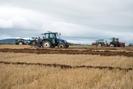 ploughing: tractors competing in the national ploughing championships in ireland Stock Photo
