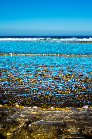lashing: calm soft waves lashing onto ballybunion beach in county kerry ireland