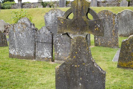 ancient ireland celtic cross: gravestones at ancient graveyard in St Canice�??s Cathedral in kilkenny city ireland