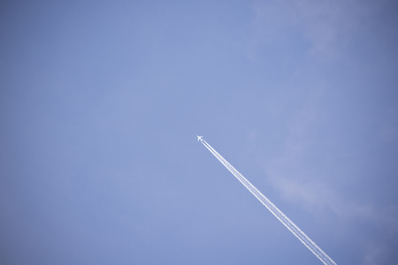 vapour: jet and its vapour trails in a cloudy blue sky Stock Photo