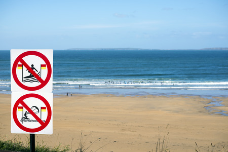 atlantic: warning signs for surfers in ballybunion on the wild atlantic way in ireland