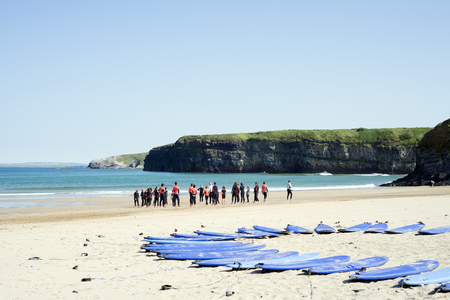 surfers paradise: people training at surf school on ballybunion beach in county kerry ireland Stock Photo