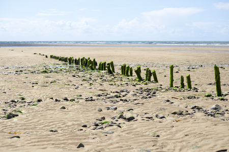 breakers: rotting wave breakers at the mouth of the cashen on ballybunion beach on the wild atlantic way Stock Photo
