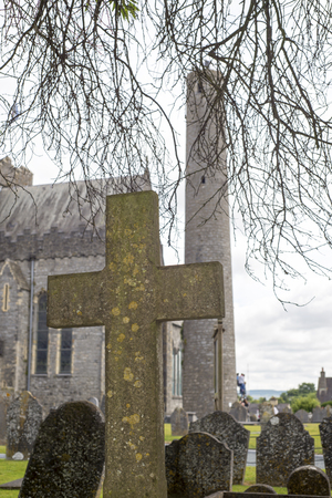 gravesite: cross at ancient graveyard in St Canice�s Cathedral in kilkenny city ireland