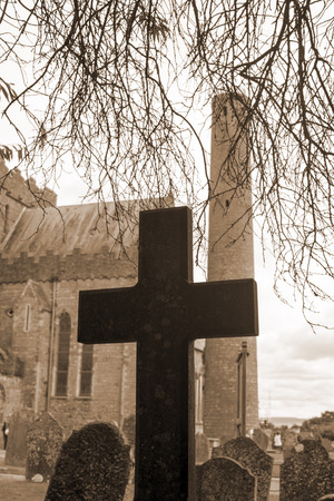 gravesite: sepia cross at ancient graveyard in St Canice�s Cathedral in kilkenny city ireland