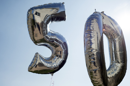 5.0: silver balloons for a 50th anniversary floating among the clouds