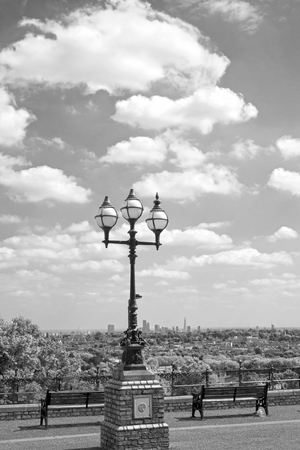 hugh: antique street light with a beautiful view of london city