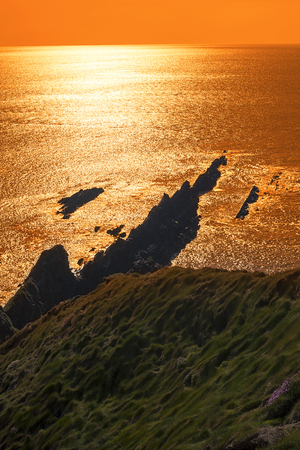 rocky jagged coastline and cliffs sunset in county kerry ireland on the wild atlantic way Stock Photo