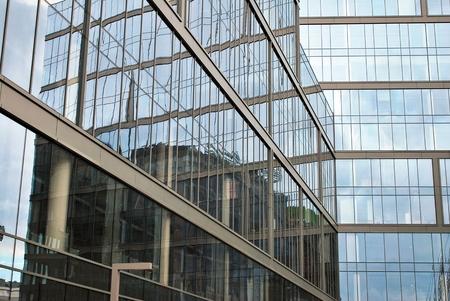 faade: Skyscraper with glass facade. Modern building. Stock Photo