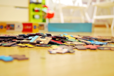 coincidence: Childrens puzzle scattered on a wooden table Stock Photo