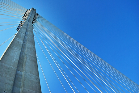 Modern bridge pylon against a blue sky Stock Photo
