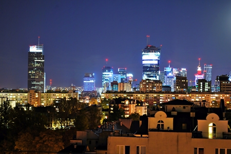 16: Warsaw, Poland. 16 September 2016. The Warsaw City skyline with urban skyscrapers at night