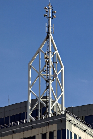 Antenna of Communication Building and blue sky.