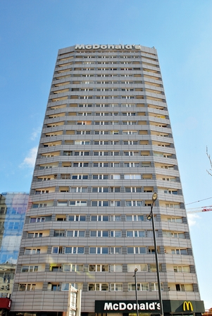 faade: Warsaw, Poland. 20 April 2017.Modern Marszalkowska Apartment Building. McDonalds logo