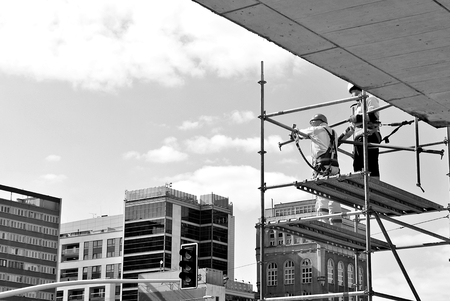 Construction workers on a scaffold. Black and white. Stok Fotoğraf