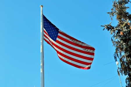valet: The American flag waving in blue sky