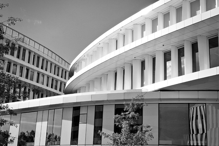 Modern office building with facade of glass. Black and white