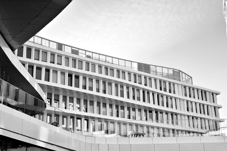 headquarters: Modern office building with facade of glass. Black and white