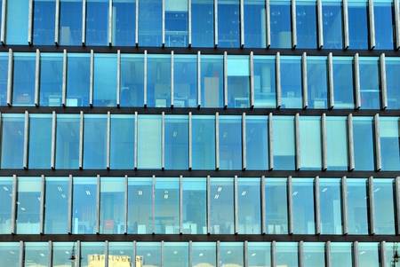 Modern building. Modern office building with a facade of glass.Blurred complex.