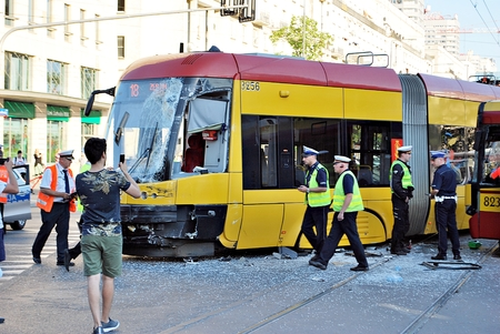 adjuster: Warsaw, Poland. 15 June 2017. Accident city bus and tram. General image of a tram accident with a bus. Editorial