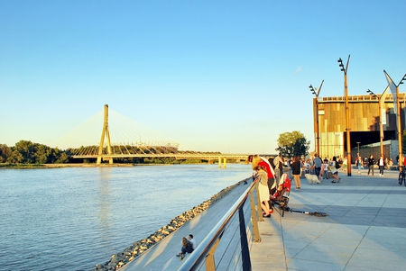 illustrative editorial: Warsaw, Poland. June 15, 2017. Vistulan Boulevards on the western side of the River Vistula in Warsaw. The promenade at the bank of the Vistula river Editorial